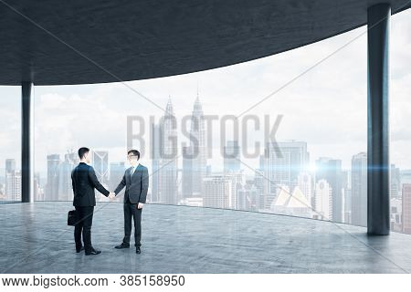 Business People Handshaking In Office Interior With Panoramic City View. Business And Teamwork Conce
