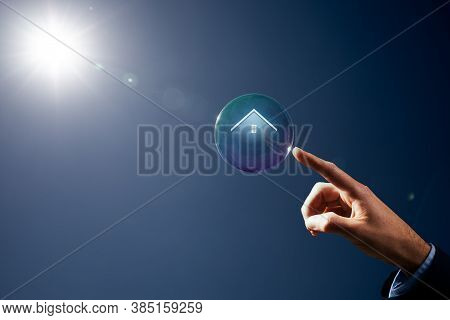 Catch Chance Of Dream House Concept. Hand With Soap Bubble (symbol Of Dream) With Symbol Of The Hous