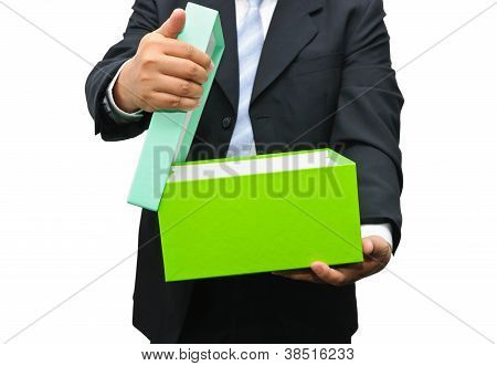 Businessman Opening A Gift Box