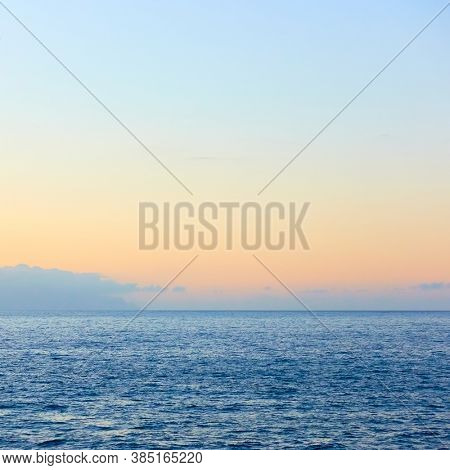 Sea horizon with almost clear sky, may be used as background