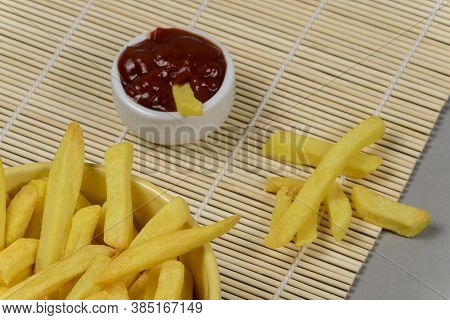 Portion Of Potato Fries In A Metal Basket