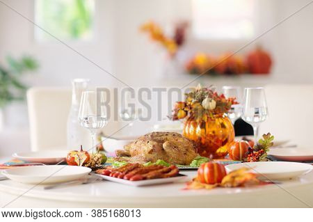 Thanksgiving Dinner. Roasted Turkey With Stuffing And Vegetables For Family Celebration.