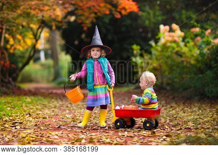 Kids Trick Or Treat On Halloween Night. Little Girl With Pumpkin Face Candy Bucket. Child Trick Or T