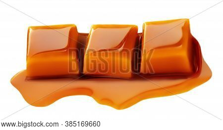 Caramel Sauce Flowing Over Caramel Candies, Isolated On White Background. Golden Butterscotch Toffee