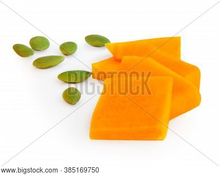 Sliced Pumpkin Pieces With Seeds Isolated On White Background