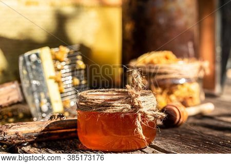 Beekeeper Collects The Honey. Beekeeper Uncapping Honeycomb With Special Beekeeping Fork.