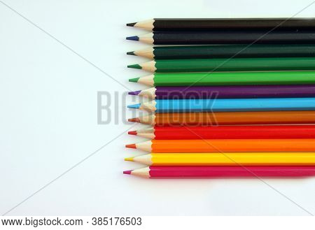 Colored Pencils On A White Background. Lots Of Different Colored Pencils. Colored Pencil. Pencils Ar