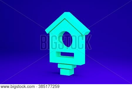 Green Bird House Icon Isolated On Blue Background. Nesting Box Birdhouse, Homemade Building For Bird