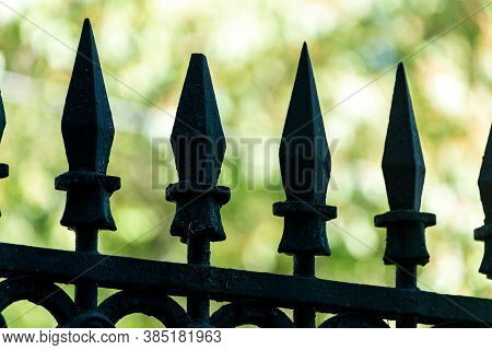 Close-up Of Metal Spikes On A Vintage City Fence
