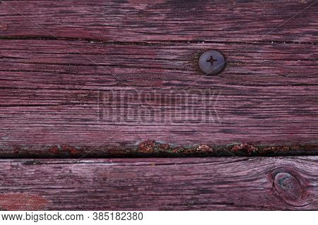 Reddish Wood Texture With Metal Screw In Roback