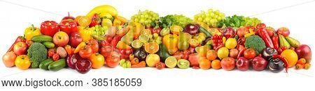 Panoramic composition of ripe, juicy fruits, berries and vegetables isolated on white background.