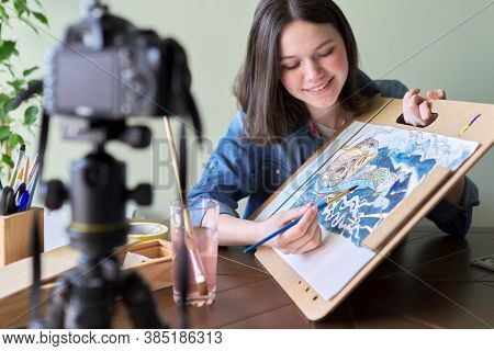 Artist, Teenage Girl, Draws Records On Video Camera For Blog. Paints, Drawings On Home, Camera On Tr