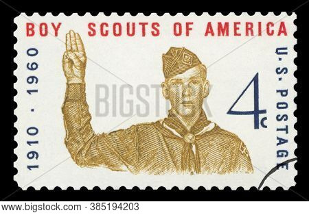 United States Of America - Circa 1960: A Stamp Printed In Usa Shows Boy Scout Giving Scout Sign, Wit