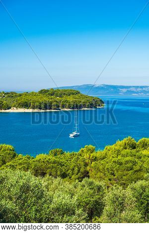 Aerial View Of Beautiful Blue Bay On Adriatic Seascape Paradise, Sail Boat In Lagoon On The Island O