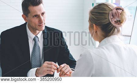 Job Seeker In Job Interview Meeting With Manager And Interviewer At Corporate Office. The Young Inte