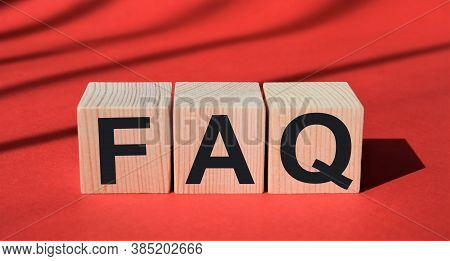 Frequently Asked Questions,inscription On Wooden Cubes On A Red Background, Questionnaire, Test Meth