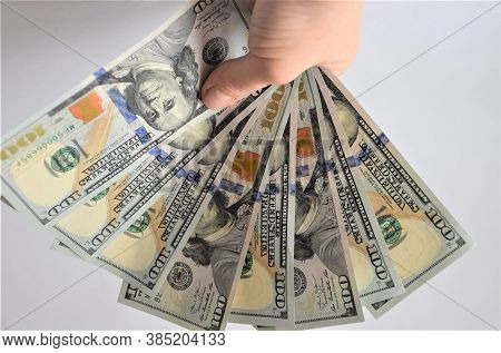 A Lot Of Dollar Bills, One Hundred Dollar Bills Held By A Man's Hand On A White Background, Earnings