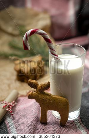 New Year's Snack With Sweet Pastries With Almonds And Milk With Striped Lollipop Decorated With A Ga