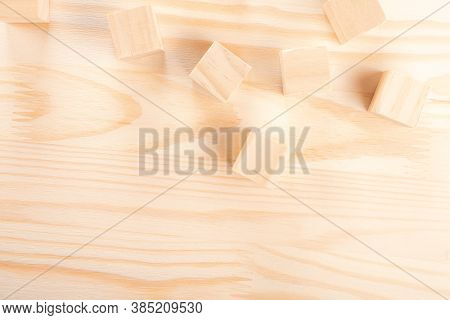 Wooden Cubes On A Light Wooden Background. Warm Wooden Background. The Concept Of Creativity, Produc