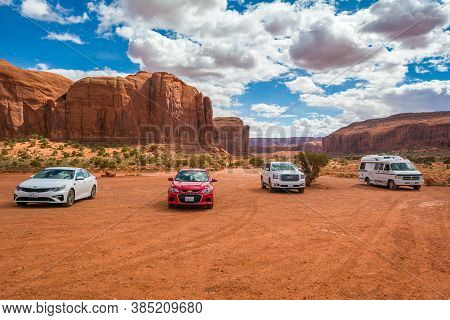 Utah/arizona, Usa: April 6, 2019: Cars Parked In Monument Valley, Navajo Tribal Park, Arizona, Usa