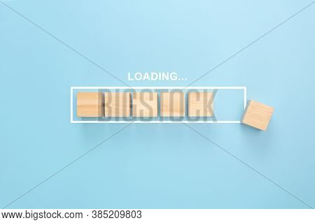 Showing Loading Bar With Wood Cube On Blue Background. Wooden Blocks With The Word Loading In Loadin
