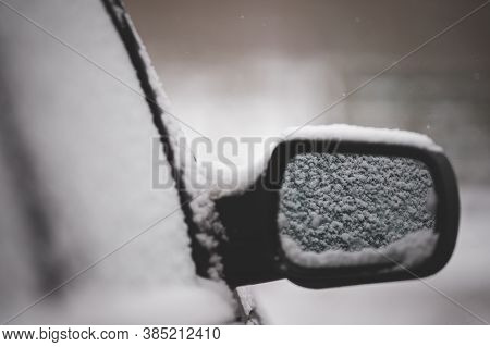 Early Winter. Unexpected Snow Covered Cars And Roads. Door Mirror And Glass Of A Car In The Snow. Ro