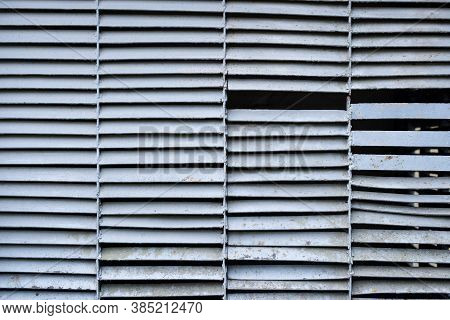 Closeup Of A Metal Ventilation Grill On The Street. Old Rusty Ventilation Grill In Front Of An Indus