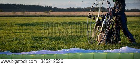 The Pilot Is Preparing For Flights A Personal Paralet With A Gasoline Engine. Paragliding For Indivi