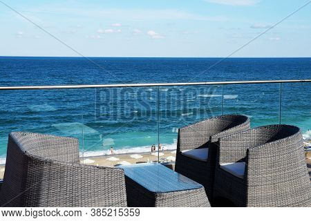 Armchairs And A Table For Relaxing On The Patio Overlooking The Sea.