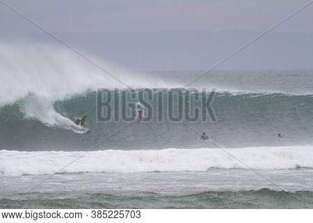 Mundaka, Bizkaia/basque Country; Nov. 01, 2013. Surfers On The Mundaka Wave On A Rainy Autumn Day.