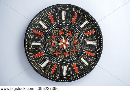 Decorative Ceramic Plate With Red And Golden Colors, Painted Plate On White Background, Closeup, Top