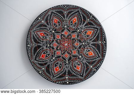 Decorative Ceramic Plate With Red And Silver Colors, Painted Plate On White Background, Closeup, Top
