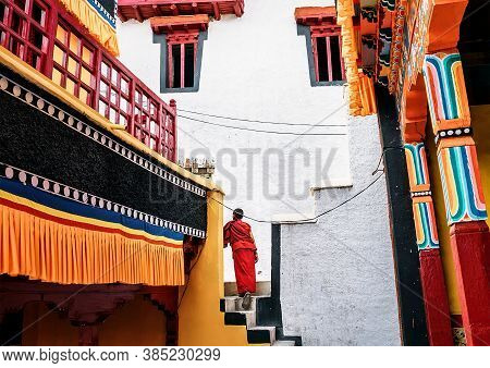 Thiksay Monastery In Thiksey Village, India - August 20, 2016: Young Monk Boy Goes By The Monastery