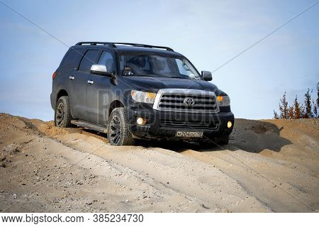 Novyy Urengoy, Russia - September 6, 2020: Black Offroad Suv Toyota Sequoia In The Sand Desert.