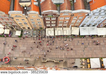 Gdansk, Poland - July 25, 2019: Top view of Gdansk old town, Poland. Tourists walking at Long Market street in Gdansk