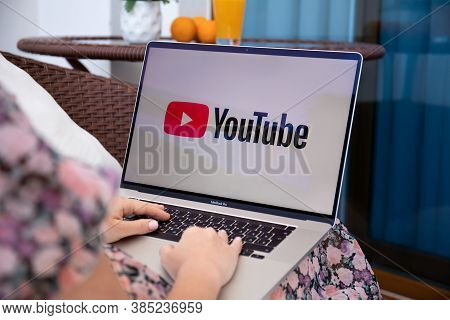 Alanya, Turkey - June 8, 2020: Woman Hand Apple Macbook Pro 16 With App Youtube Provides Streaming M