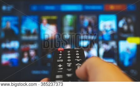 Male Hand With Remote Control Pointing On Smart Tv.