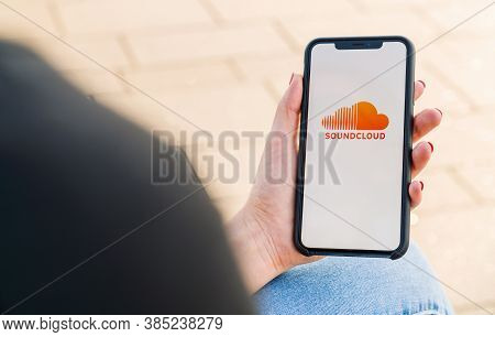 Berlin, Germany August 2019: Woman Hand Holding Iphone Xs Opening Soundcloud Music Streaming App In