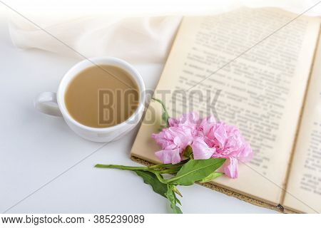 Romantic Vintage Still Life With Pink Flowers, Old Book, Cup Of Tea Or Coffee In Spring, Summer Day
