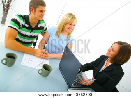 Happy Couple Discussing With Real Estate Broker