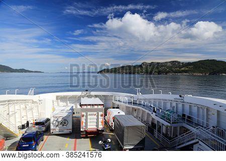 Bjornafjord, Norway - July 23, 2020: Passenger And Car Ferry Crosses Bjornafjord In Norway. Public T