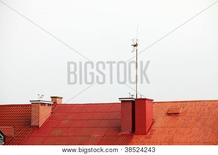 Antenne On Red Roof White Sky