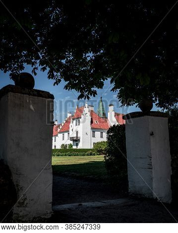 The Exterior Of Bosjökloster Castle Seen From An Old Gate During Summertime
