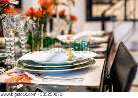 Tables Set For An Event Party. Luxury Elegant Table Setting Dinner In A Restaurant. Glasses And Dish