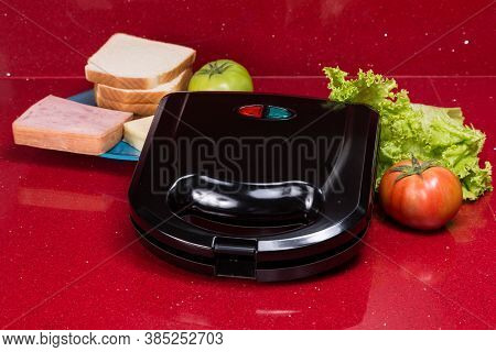 Sandwich Maker; Photo With Ingredients To Make Sandwiches.