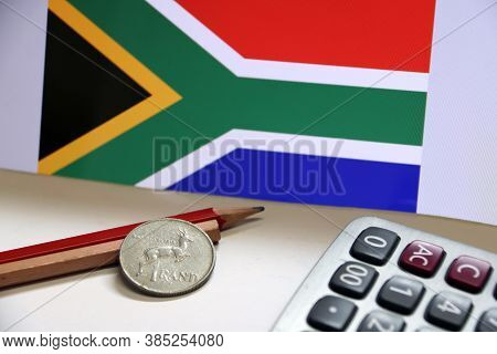 Coin Of South Africa In Reverse Of A Coin With Deer Form On Wooden And Red Pencil With Calculator On