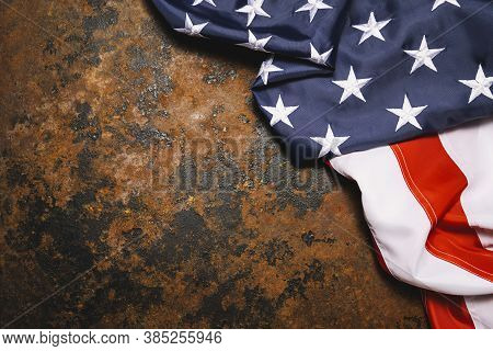 American Flag On Dark Rusty Metal With Free Space. 4th July Veterans Or Us Independence Day.