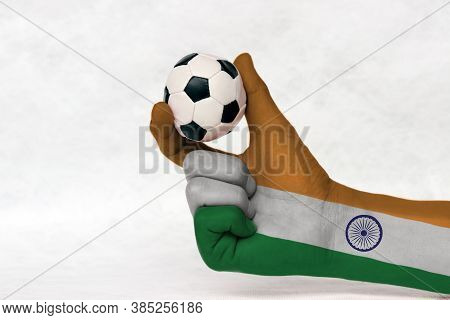 Mini Ball Of Football In India Flag Painted Hand, Hold It With Two Finger On White Background. Conce