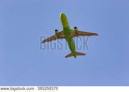 Airbus A320 Of S7 Airlines With Tail Number Vq-brd Flies Over The Observer. View From The Ground To