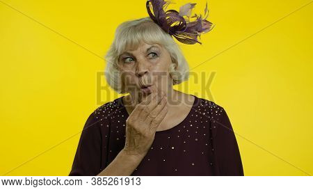 Shocked Frightened Senior Old Woman Covering Mouth With Hand And Looking Terrified At Camera, Scared